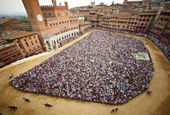 Sienese crush ... a crowd in Piazza del Campo awaits the action.